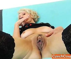 Blond-haired mature with a dildo..