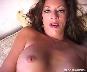 Sexy cougar strips and frigs her..