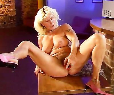 Hairy mature plays with herself