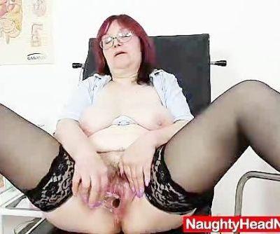 Redhead huge boobies cougar..