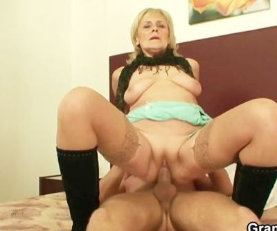 Granny prostitute jumps on his..