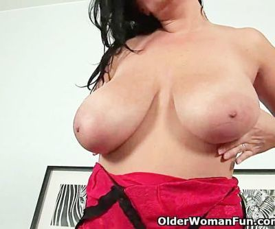 Sultry milf with big tits fucks..