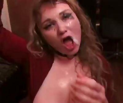 Whore throat fucks huge dildo..