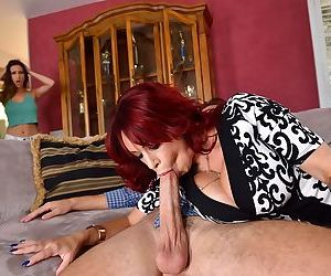 Mature redhead Alyssa Lynn is caught blowing her stepdaughters boyfriend