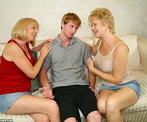Lucky student got his fat cock shared between two lovely mature ladies