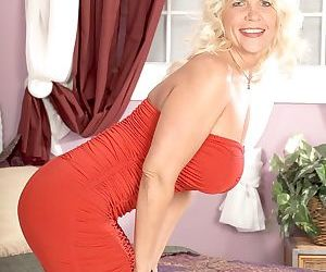 Mature woman Jerrika Micheals removes her red dress to please her wet twat