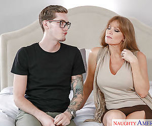 Horny cougar Darla Crane seducing glasses wearing nerd with huge dick