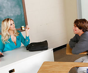 Mature ambitious teacher Julia Ann gives pussy to her horny student