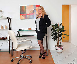 Mature businesswoman Kelly Leigh masturbates behind inside her office