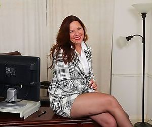 Older office worker Bobby Jackson undressing for spreading of shaved vagina