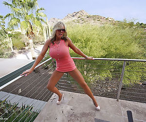 Clothed blonde housewife Sandra Otterson modeling on balcony and pool table - part 2