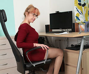 Mature chick gets naked in the office and fucks herself with a dildo toy