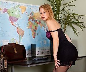 Sexy office worker Trinity strips down to sexy lingerie and pantyhose
