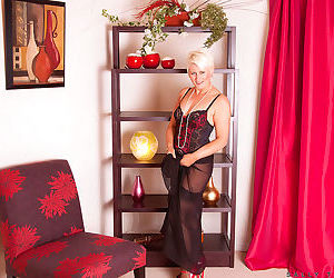 Mature woman Sally Taylor plays with her pearls while displaying her pussy