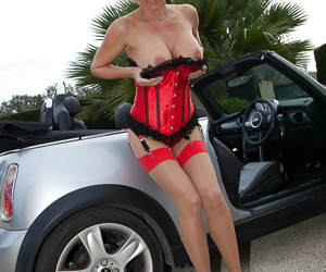 Hot Euro lady Jan Burton flashing stocking tops and garters outdoors - part 2
