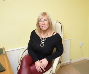 Mature office slut Melody takes her sexy leather pants off and poses