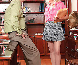 Big titted mature in hold up stockings Marina Johnson stripping and jerking a cock