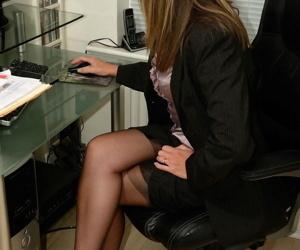 Hot mature secretary Satin Jayde peels down to her black stockings at work