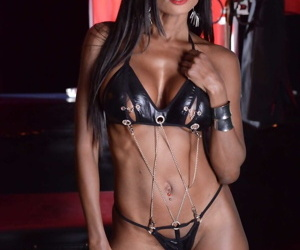 Black chick Diamond Jackson teasingly works free of leather bikini