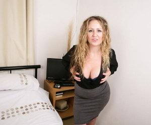 British lady works her way clear of office attire to masturbate with sex toy