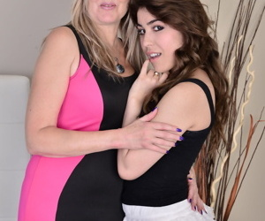 Bisexual Canadian mom and her teen lover lick each others lesbian pussy