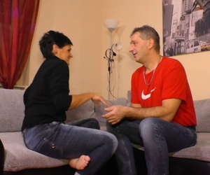 Amateur German man has fun with black-haired woman in living room