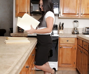 Horny mature vixen in glasses undressing and teasing her slit in the kitchen