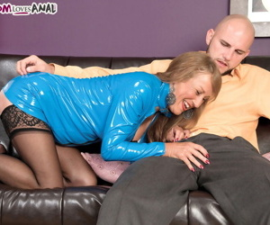 Hot older woman seduces a young boy in blue latex and black stockings