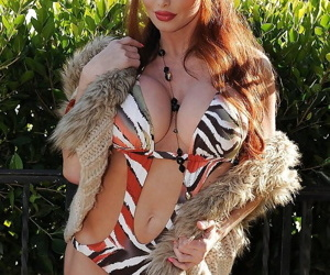 Sexy mature lady Taylor Wane showcasing her curvaceous body outdoor