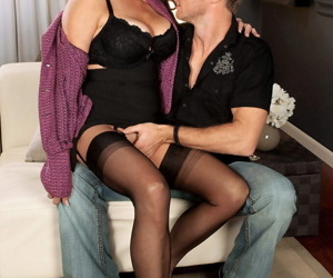 Hot older woman Rita Daniels seduces her young lover in sensual lingerie