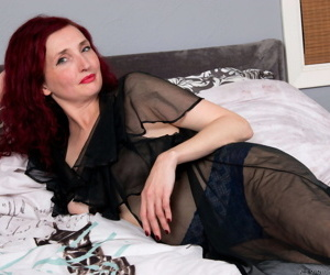 Mature redhead Zinnia Blue spreads her pussy lips with painted fingernails