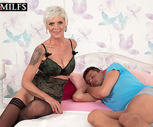 Short haired woman over 50 Nicol Mandorla wakes her guy up with oral sex