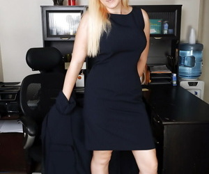 Blonde secretary Prudence Pond showing off ample bust in office