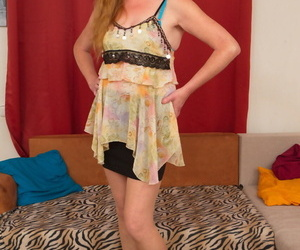 Mature redheaded women dildos her trimmed pussy in tan stockings