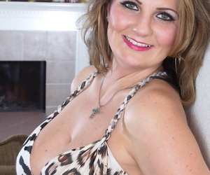 Mature wife Cherrie Dixon strips off to bare her hot pussy and nice tits