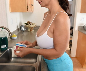 Horny housewife Mindi Mink soaks white top & flashes hairy pussy in kitchen