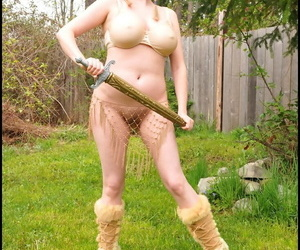 Mature blonde Tasty Trixie shows off her great tits outside in Viking attire