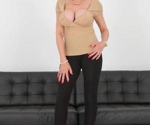 Mature MILF Lady Sonia slides black leggings over thong laden ass
