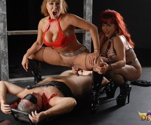 Mature pornstar Ava Devine and a busty redhead face sit and ride a male slave