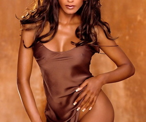 Ebony Playboy darling Traci Bingham bares her big fake tits and long legs