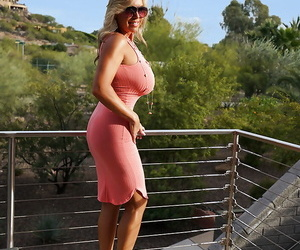 Clothed blonde housewife Sandra Otterson modeling on balcony and pool table