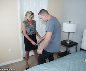 Older blonde lady Payton Hall giving large penis handjob and blowjob
