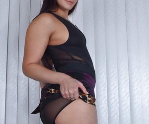 Older brunette solo girl Sheena Ryder flaunting hairy bush in stockings