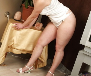 Fatty mature woman showing off her ample ass and shaggy twat