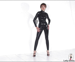 Leggy mature fetish lady posing in latex suit and high-heeled shoes