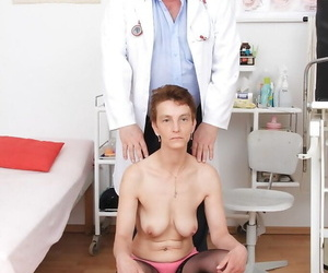 Short haired granny Rozi spreading hairy pussy for pervert doctor