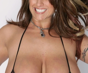 MILF Eva Notty shows her big fakte tits before posing with Kelly Madison