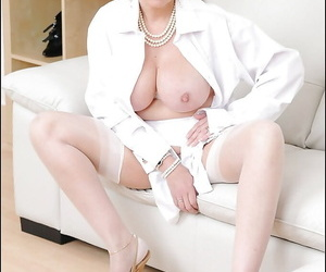 Mature fetish lady with big jugs and ample ass poses barely clothed