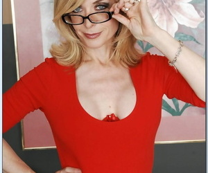 Sex-hungry mature lassie Nina Hartley revealing her jugs and inviting twat