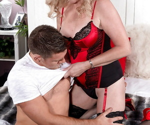 Older blonde woman Val Kambel getting screwed by younger man in stockings